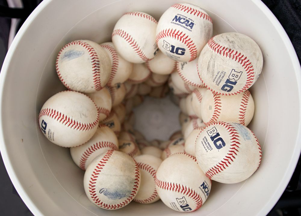 Big Ten baseballs sit in a bucket before the college baseball game at Duane Banks Field in Iowa City on Wednesday, March 11, 2020. (Stephen Mally/hawkeyesports.com)