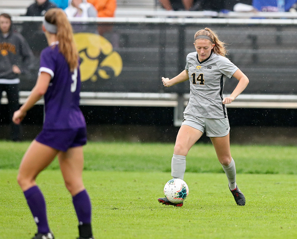 Iowa defender Leah Moss (14) moves with the ball during the first half of their match at the Iowa Soccer Complex in Iowa City on Sunday, Sep 29, 2019. (Stephen Mally/hawkeyesports.com)