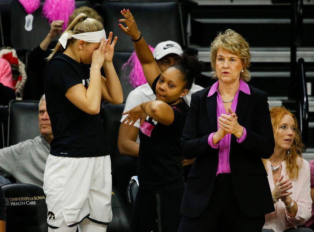 Iowa Hawkeyes forward Carly Mohns (34), Iowa Hawkeyes guard Tania Davis (11), Iowa Hawkeyes head coach Lisa Bluder