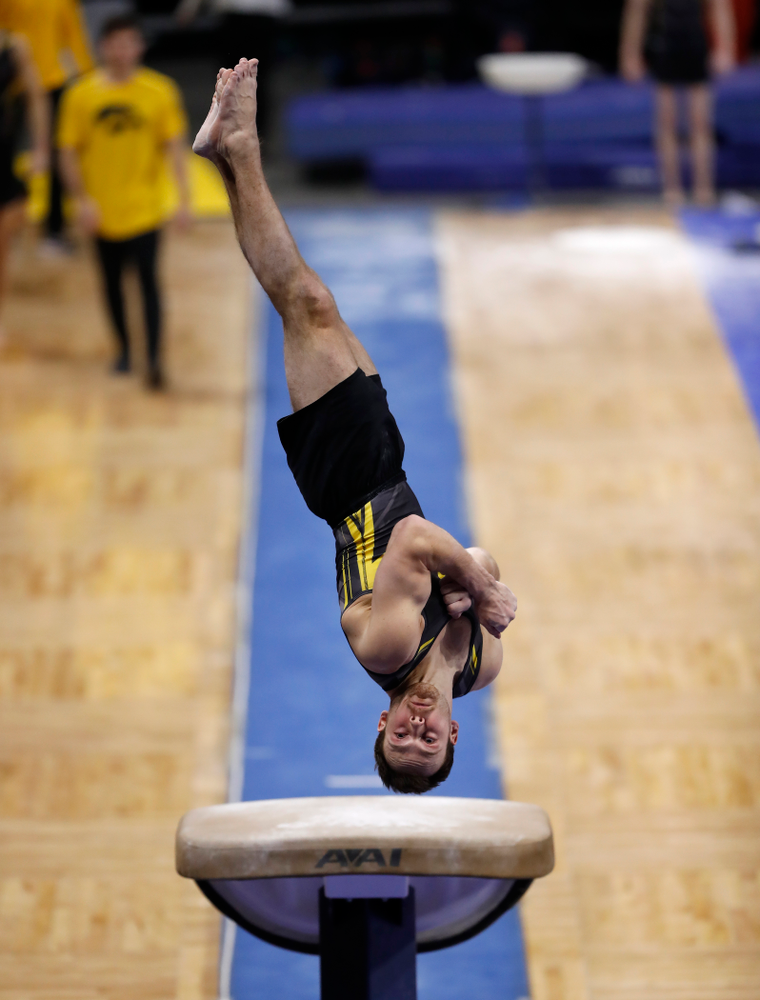 Dylan Ellsworth competes on the vault against Illinois