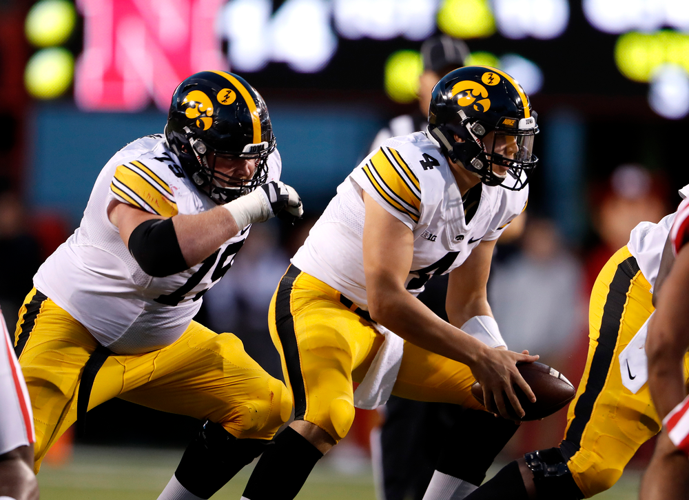 Iowa Hawkeyes offensive lineman Sean Welsh (79) and quarterback Nathan Stanley (4)