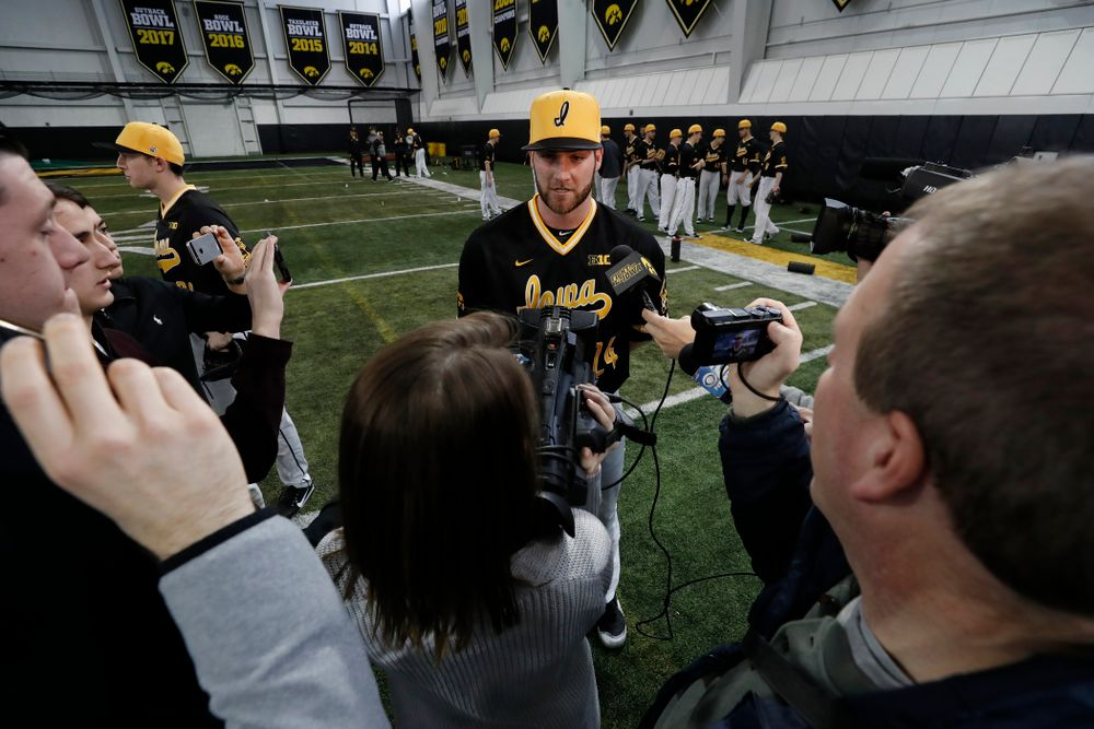 Iowa Hawkeyes pitcher Nick Allgeyer (24) answers questions from reporters during the team's annual media day Thursday, February 8, 2018 in the indoor practice facility. (Brian Ray/hawkeyesports.com)