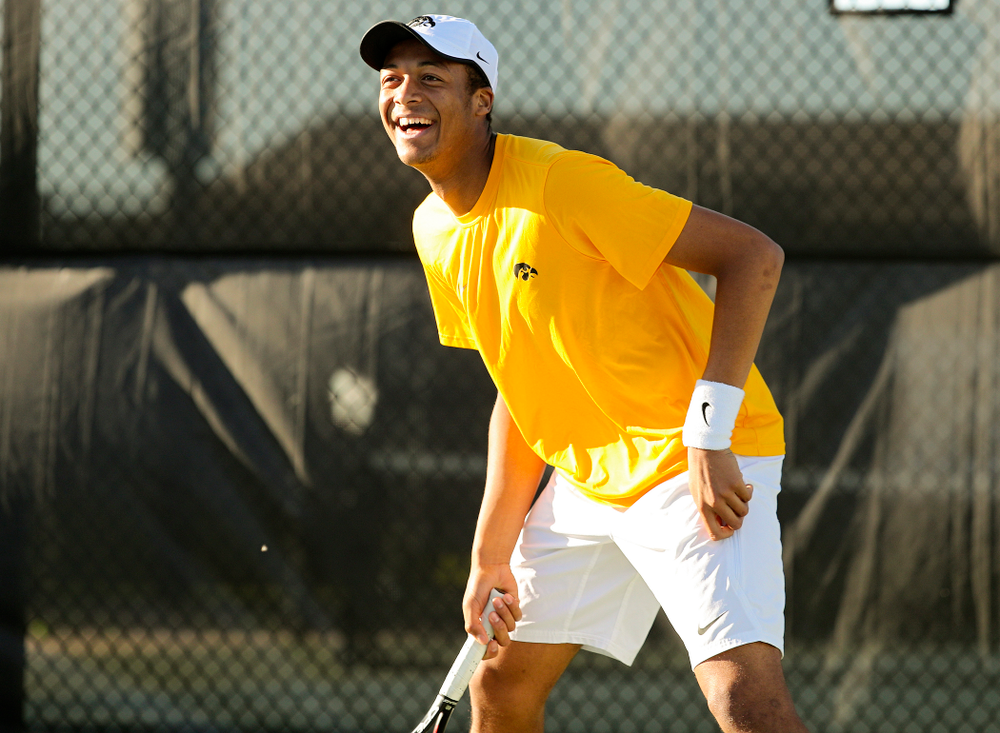 Iowa's Oliver Okonkwo smiles during their doubles match again Michigan State at the Hawkeye Tennis and Recreation Complex in Iowa City on Friday, Apr. 19, 2019. (Stephen Mally/hawkeyesports.com)