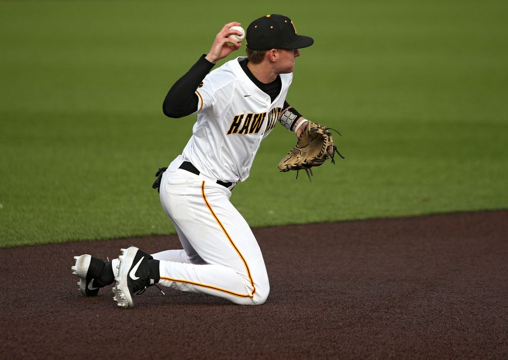 Iowa infielder Brendan Sher (2) throws to second base as they turn a double play during the eighth inning of their college baseball game at Duane Banks Field in Iowa City on Wednesday, March 11, 2020. (Stephen Mally/hawkeyesports.com)