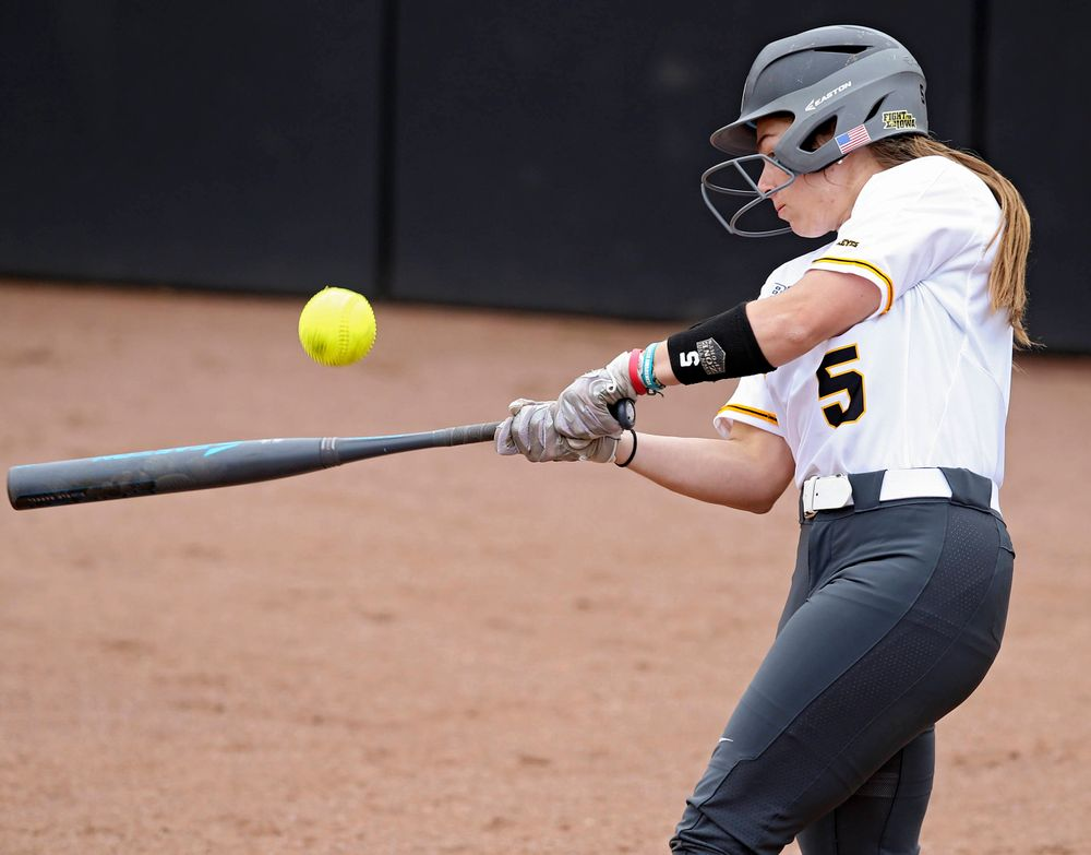Iowa Hawkeyes Sydney Owens (5) connects on a pitch during the second inning of their Big Ten Conference softball game at Pearl Field in Iowa City on Friday, Mar. 29, 2019. (Stephen Mally/hawkeyesports.com)