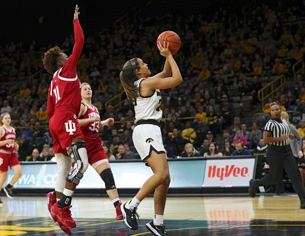 Iowa Hawkeyes guard Gabbie Marshall (24) makes a basket during the third quarter of their game at Carver-Hawkeye Arena in Iowa City on Sunday, January 12, 2020. (Stephen Mally/hawkeyesports.com)