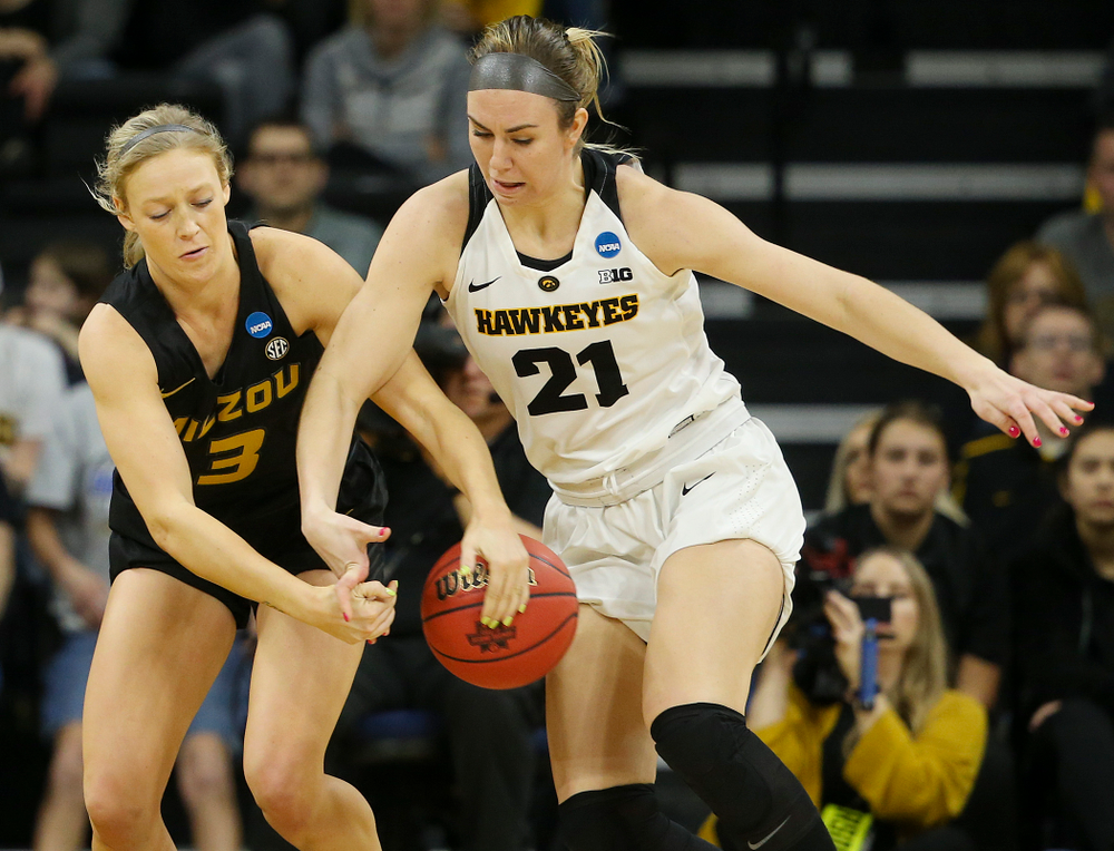Missouri Tigers guard Sophie Cunningham (3) and Iowa Hawkeyes forward Hannah Stewart (21) battle for a loose ball during the third quarter of their second round game in the 2019 NCAA Women's Basketball Tournament at Carver Hawkeye Arena in Iowa City on Sunday, Mar. 24, 2019. (Stephen Mally for hawkeyesports.com)