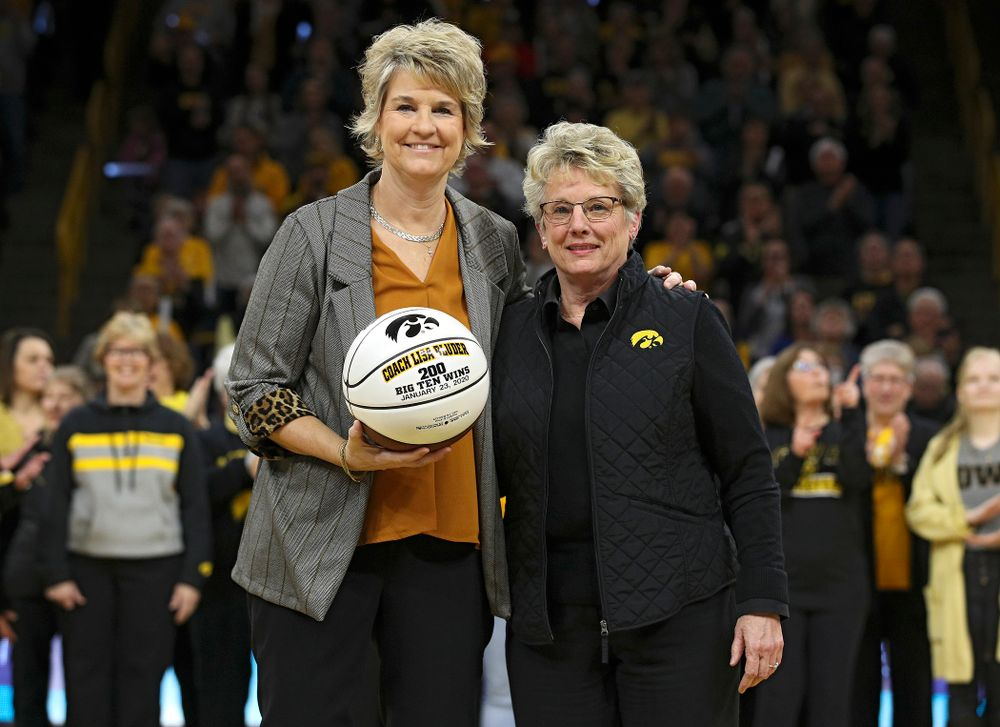 Iowa Hawkeyes head coach Lisa Bluder is recognized for her 200th Big Ten win with Barbara Burke, Deputy Director of Athletics and Senior Woman Administrator, before the game at Carver-Hawkeye Arena in Iowa City on Thursday, February 6, 2020. (Stephen Mally/hawkeyesports.com)