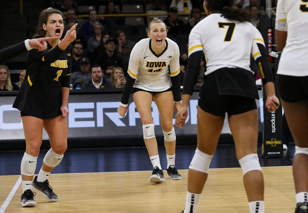 Iowa Hawkeyes defensive specialist Molly Kelly (1) and Iowa Hawkeyes outside hitter Cali Hoye (14) celebrate after winning a point during a match against Rutgers at Carver-Hawkeye Arena on November 2, 2018. (Tork Mason/hawkeyesports.com)
