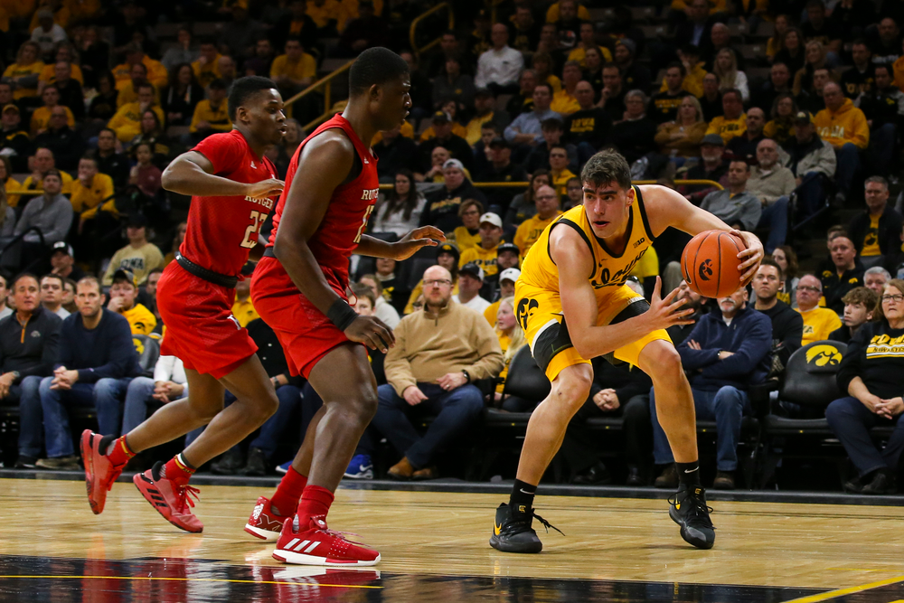 Iowa Hawkeyes center Luka Garza (55) looks to pass the ball during the Iowa men's basketball game vs Rutgers on Wednesday, January 22, 2020 at Carver-Hawkeye Arena. (Lily Smith/hawkeyesports.com)