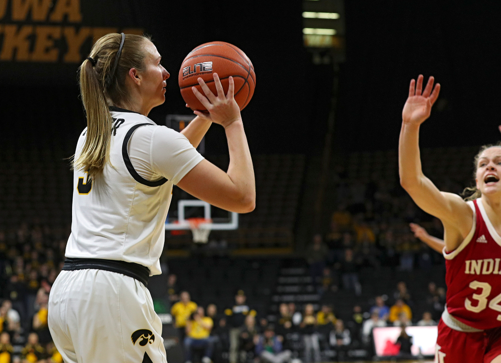 Iowa Hawkeyes guard Makenzie Meyer (3) makes a 3-pointer during the fourth quarter of their game at Carver-Hawkeye Arena in Iowa City on Sunday, January 12, 2020. (Stephen Mally/hawkeyesports.com)