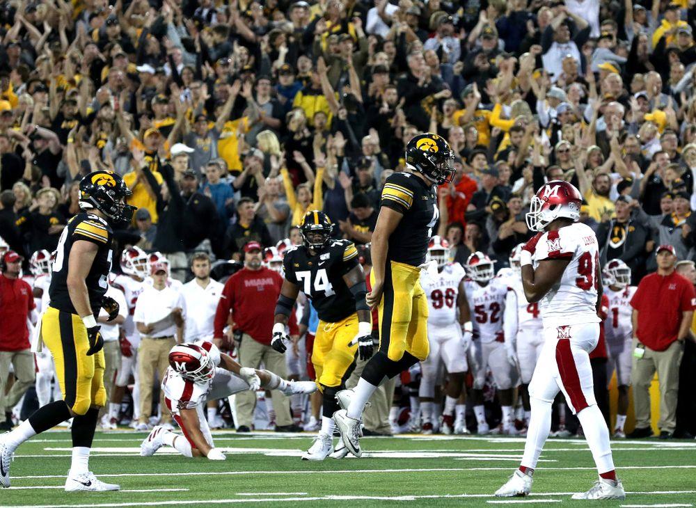 Iowa Hawkeyes quarterback Nate Stanley (4) celebrates a touchdown against the Miami RedHawks Saturday, August 31, 2019 at Kinnick Stadium in Iowa City. (Brian Ray/hawkeyesports.com)