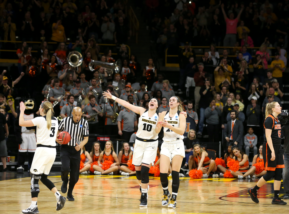 Iowa Hawkeyes guard Makenzie Meyer (3), forward Megan Gustafson (10), and forward Hannah Stewart (21) after winning their game during the first round of the 2019 NCAA Women's Basketball Tournament at Carver Hawkeye Arena in Iowa City on Friday, Mar. 22, 2019. (Stephen Mally for hawkeyesports.com)