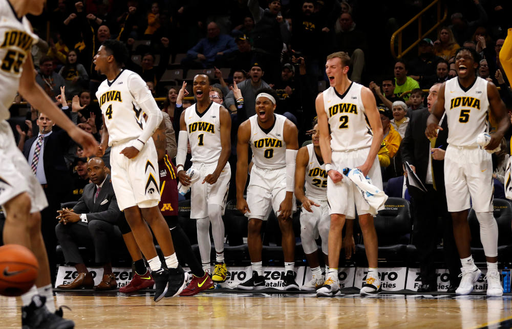 Iowa Hawkeyes guard Maishe Dailey (1), forward Ahmad Wagner (0), and forward Jack Nunge (2)