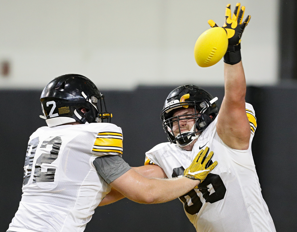 Iowa Hawkeyes defensive lineman Dalles Jacobus (66) knocks down a pass as he is blocked by defensive lineman John Waggoner (92) during Fall Camp Practice No. 9 at the Hansen Football Performance Center in Iowa City on Monday, Aug 12, 2019. (Stephen Mally/hawkeyesports.com)