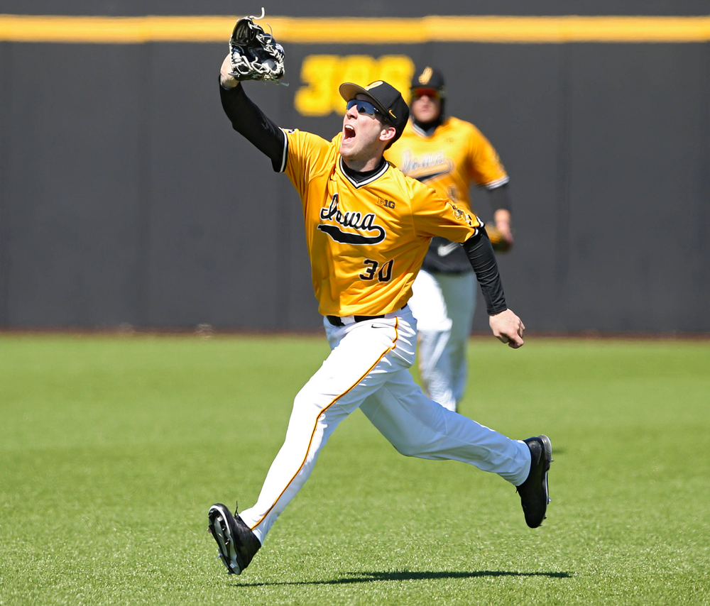 Iowa Hawkeyes Connor McCaffery (30) makes a running catch for an out during the fourth inning against Illinois at Duane Banks Field in Iowa City on Sunday, Mar. 31, 2019. (Stephen Mally/hawkeyesports.com)