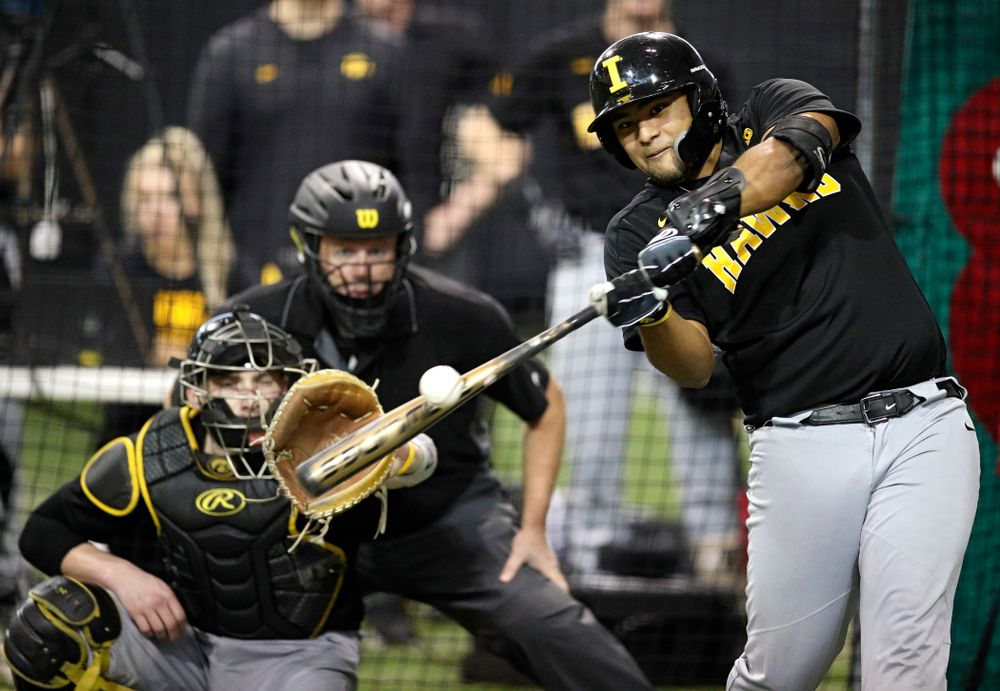 Iowa Hawkeyes infielder Izaya Fullard (20) bats during practice at the Hansen Football Performance Center in Iowa City on Friday, January 24, 2020. (Stephen Mally/hawkeyesports.com)