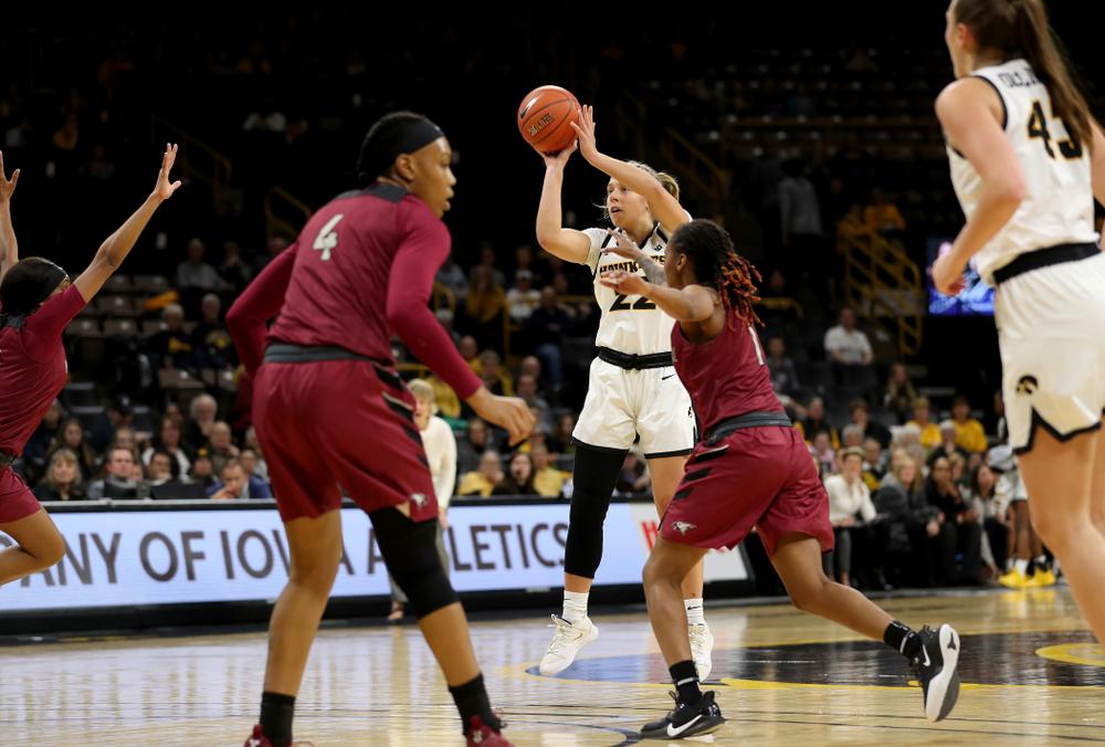 Iowa Hawkeyes guard Kathleen Doyle (22) knocks down a three point basket against North Carolina Central Saturday, December 14, 2019 at Carver-Hawkeye Arena. (Brian Ray/hawkeyesports.com)