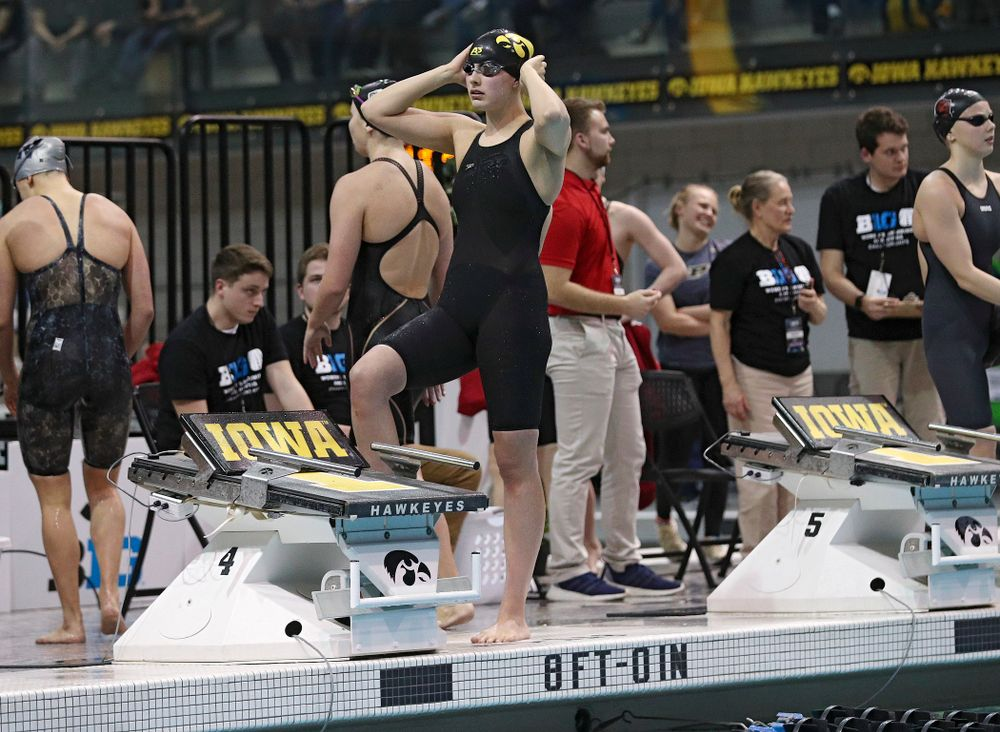 Iowa's Hannah Burvill waits to swim the women's 100 yard freestyle consolation final event during the 2020 Women's Big Ten Swimming and Diving Championships at the Campus Recreation and Wellness Center in Iowa City on Saturday, February 22, 2020. (Stephen Mally/hawkeyesports.com)
