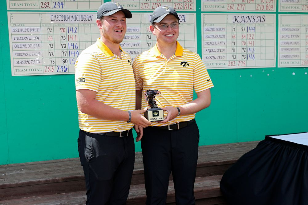 Iowa's Alex Schaake (from left) and Matthew Walker hold their trophy after winning the Hawkeye Invitational at Finkbine Golf Course in Iowa City on Sunday, Apr. 21, 2019. (Stephen Mally/hawkeyesports.com)
