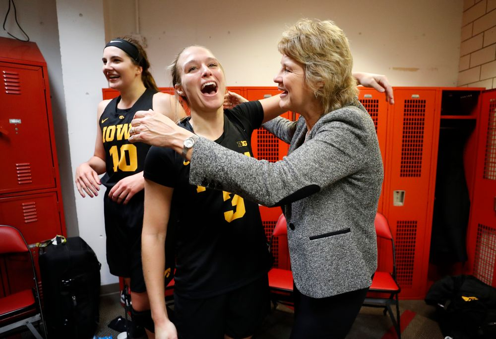 Iowa Hawkeyes guard Makenzie Meyer (3) and head coach Lisa Bluder