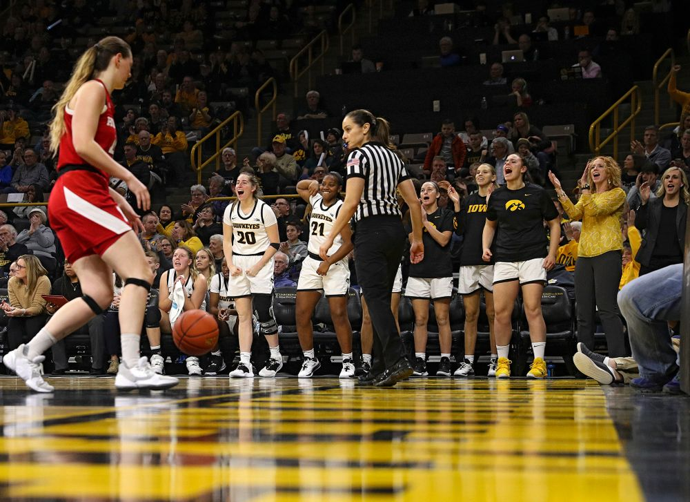 The Iowa Hawkeyes bench celebrates after forward Amanda Ollinger (not pictured) make a basket during the fourth quarter of the game at Carver-Hawkeye Arena in Iowa City on Thursday, February 6, 2020. (Stephen Mally/hawkeyesports.com)