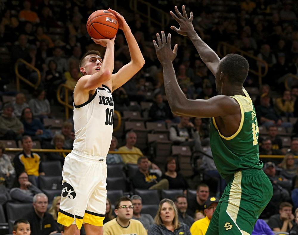 Iowa Hawkeyes guard Joe Wieskamp (10) makes a 3-pointer during the second half of their game at Carver-Hawkeye Arena in Iowa City on Sunday, Nov 24, 2019. (Stephen Mally/hawkeyesports.com)