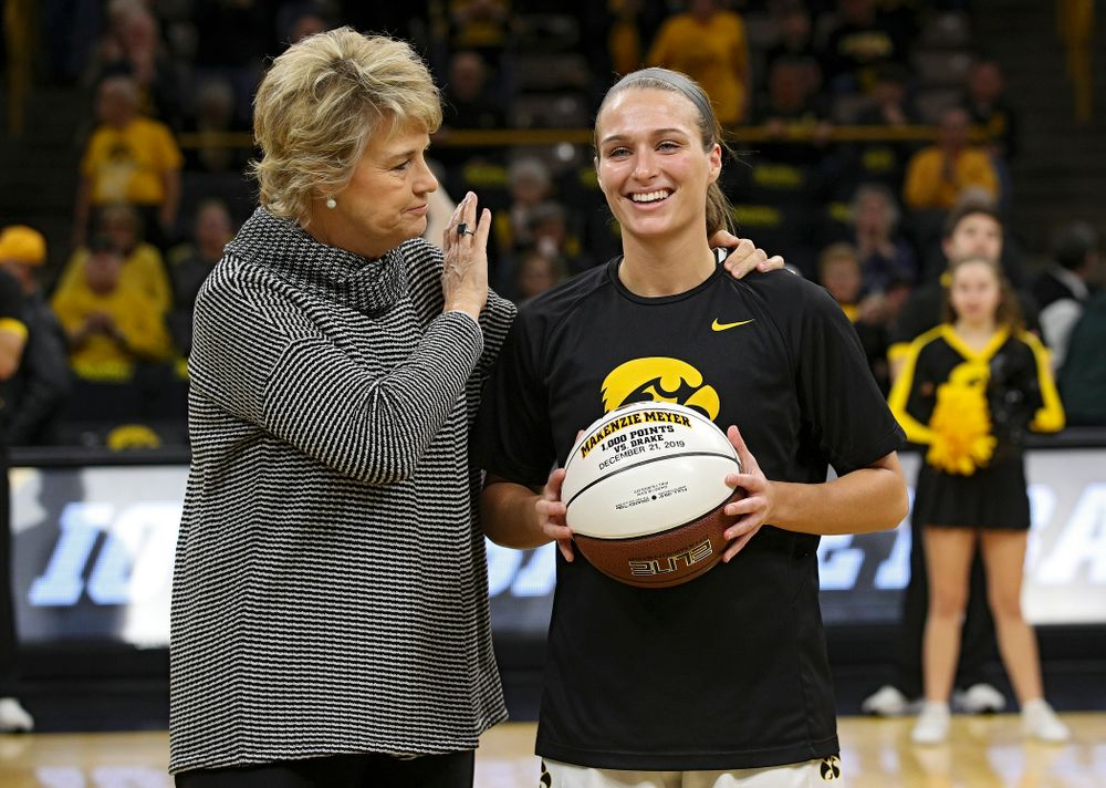 Iowa Hawkeyes head coach Lisa Bluder presents guard Makenzie Meyer (3) with a ball to honor her for scoring 1,000 career points before their game at Carver-Hawkeye Arena in Iowa City on Tuesday, December 31, 2019. (Stephen Mally/hawkeyesports.com)