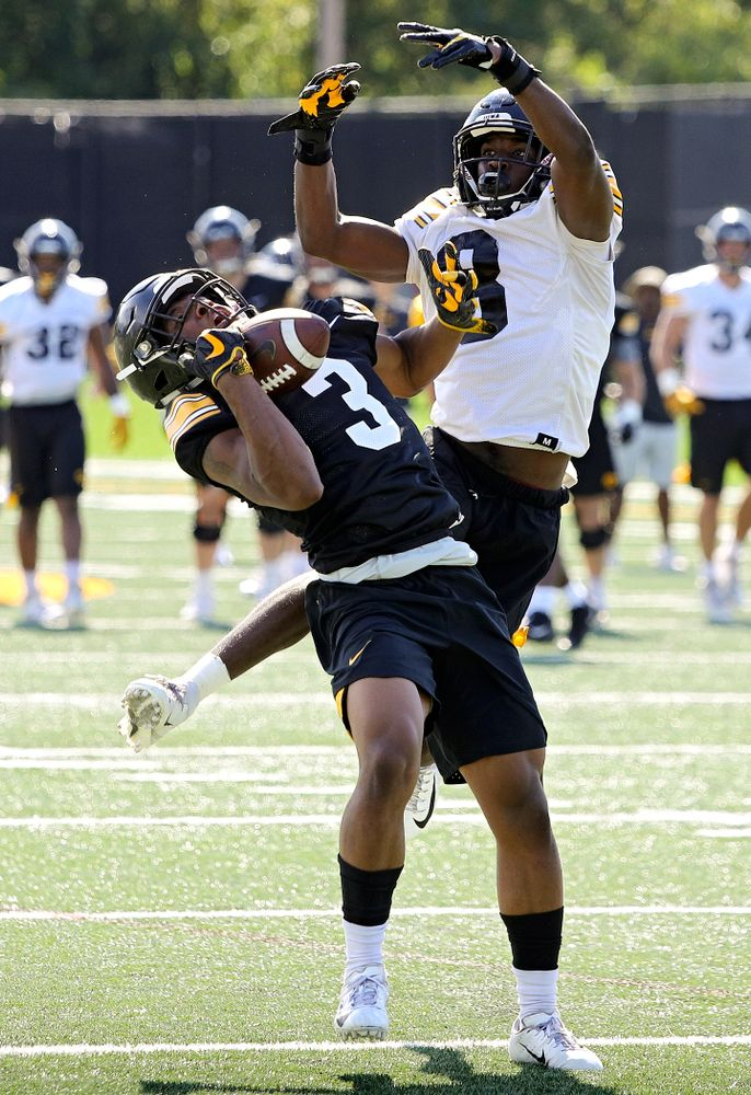 Iowa Hawkeyes wide receiver Tyrone Tracy Jr. (3) gathers in a pass around defensive back Matt Hankins (8) during Fall Camp Practice No. 13 at the Hansen Football Performance Center in Iowa City on Friday, Aug 16, 2019. (Stephen Mally/hawkeyesports.com)