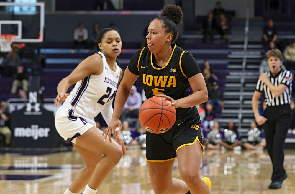 Iowa Hawkeyes guard Alexis Sevillian (5) drives with the ball during the third quarter of their game at Welsh-Ryan Arena in Evanston, Ill. on Sunday, January 5, 2020. (Stephen Mally/hawkeyesports.com)