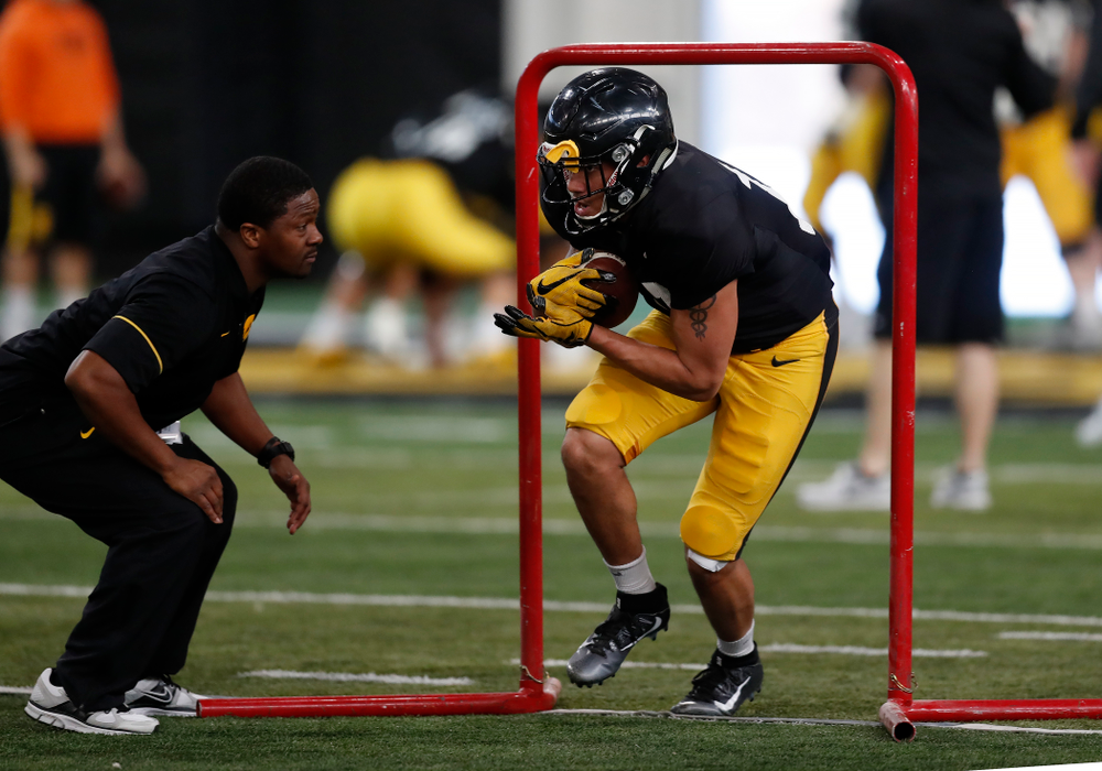 Iowa Hawkeyes running back Camron Harrell (10) and running backs coach Derrick Foster during spring practice Wednesday, March 28, 2018 at the Hansen Football Performance Center.  (Brian Ray/hawkeyesports.com)