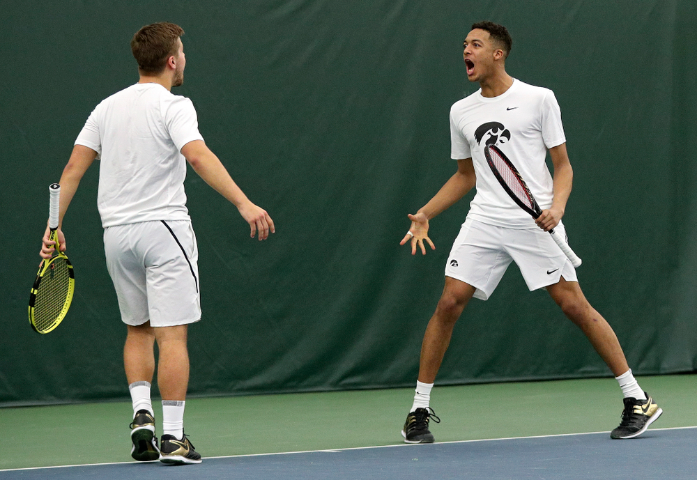 Iowa's Will Davies (from left) and Oliver Okonkwo celebrate a point during their doubles match at the Hawkeye Tennis and Recreation Complex in Iowa City on Sunday, February 16, 2020. (Stephen Mally/hawkeyesports.com)