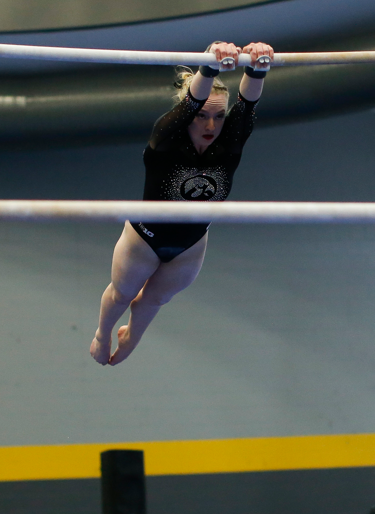 Annabelle Moser competes on the uneven bars during the Black and Gold Intrasquad meet at the Field House on 12/2/17. (Tork Mason/hawkeyesports.com)