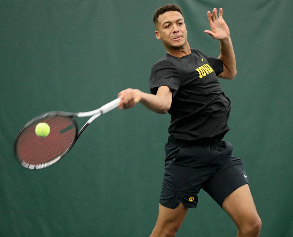 Iowa's Oliver Okonkwo returns a shot during their match at the Hawkeye Tennis and Recreation Complex in Iowa City on Thursday, January 16, 2020. (Stephen Mally/hawkeyesports.com)