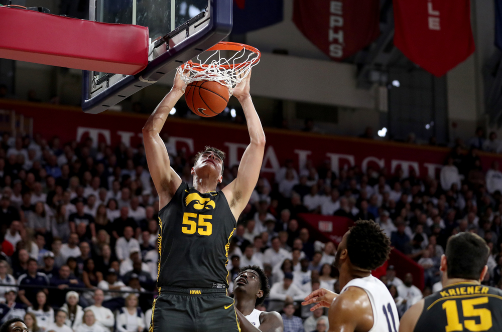 Iowa Hawkeyes forward Luka Garza (55) dunks the ball against Penn State Saturday, January 4, 2020 at the Palestra in Philadelphia. (Brian Ray/hawkeyesports.com)