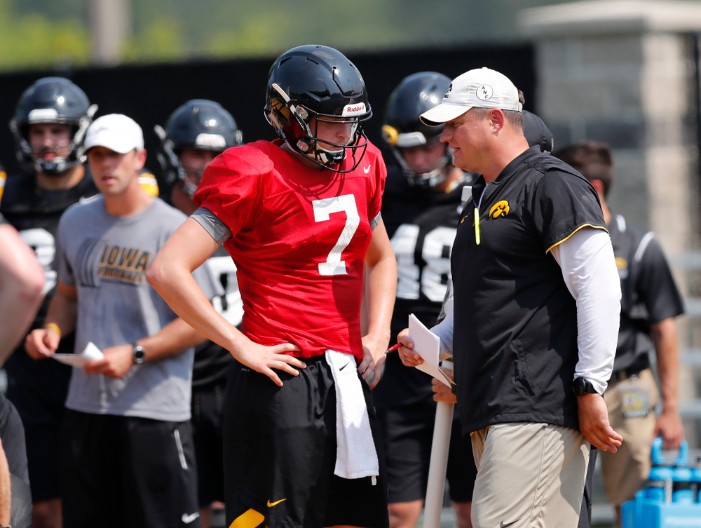 Iowa Hawkeyes quarterback Spencer Petras (7) and offensive coordinator Brian Ferentz during fall camp practice No. 9 Friday, August 10, 2018 at the Kenyon Practice Facility. (Brian Ray/hawkeyesports.com)