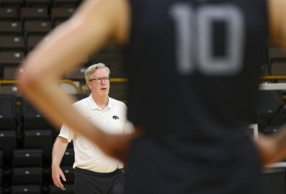 Iowa Hawkeyes head coach Fran McCaffery talks with his players as guard Joe Wieskamp (10) looks on during practice at Carver-Hawkeye Arena in Iowa City on Monday, Sep 30, 2019. (Stephen Mally/hawkeyesports.com)