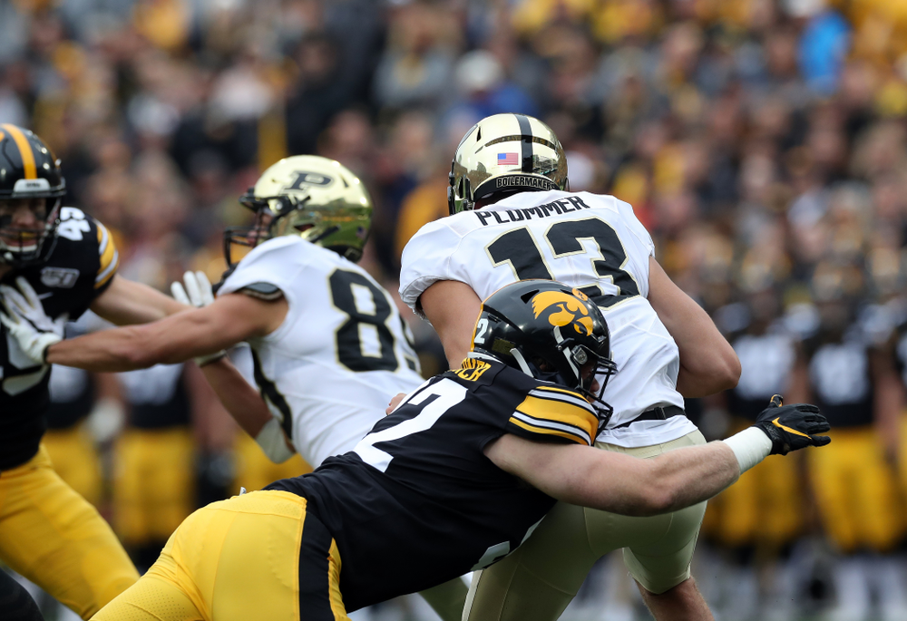 Iowa Hawkeyes defensive lineman John Waggoner (92) sacks Purdue quarterback Jack Plummer Saturday, October 19, 2019 at Kinnick Stadium. (Brian Ray/hawkeyesports.com)