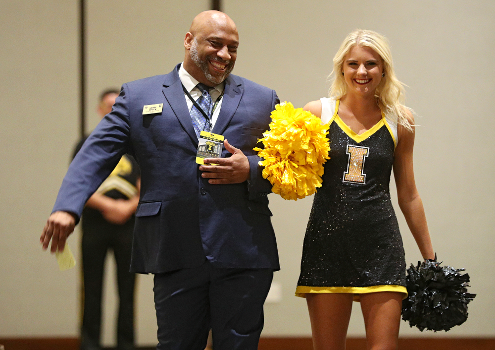 2019 University of Iowa Athletics Hall of Fame inductee LeRoy Smith walks to his seat with a Spirit Squad member during the Hall of Fame Induction Ceremony at the Coralville Marriott Hotel and Conference Center in Coralville on Friday, Aug 30, 2019. (Stephen Mally/hawkeyesports.com)