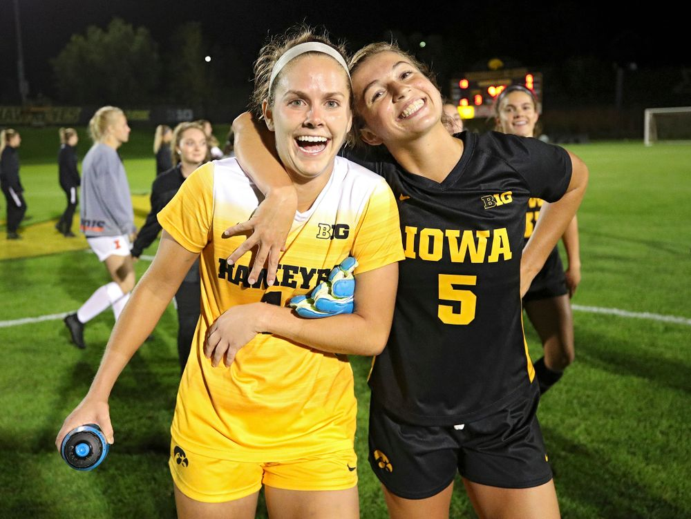 Iowa goalkeeper Claire Graves (1) and defender Riley Whitaker (5) celebrate together after their match against Illinois at the Iowa Soccer Complex in Iowa City on Thursday, Sep 26, 2019. (Stephen Mally/hawkeyesports.com)