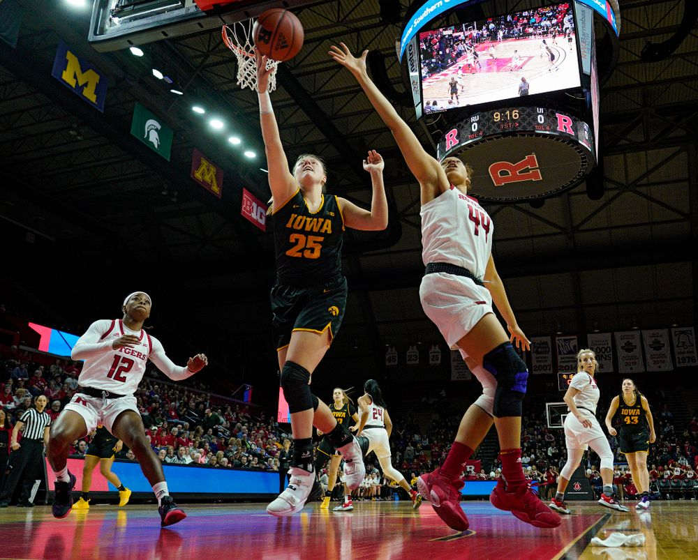 Iowa forward/center Monika Czinano (25) tries to pull in a pass during the first quarter of their game at the Rutgers Athletic Center in Piscataway, N.J. on Sunday, March 1, 2020. (Stephen Mally/hawkeyesports.com)