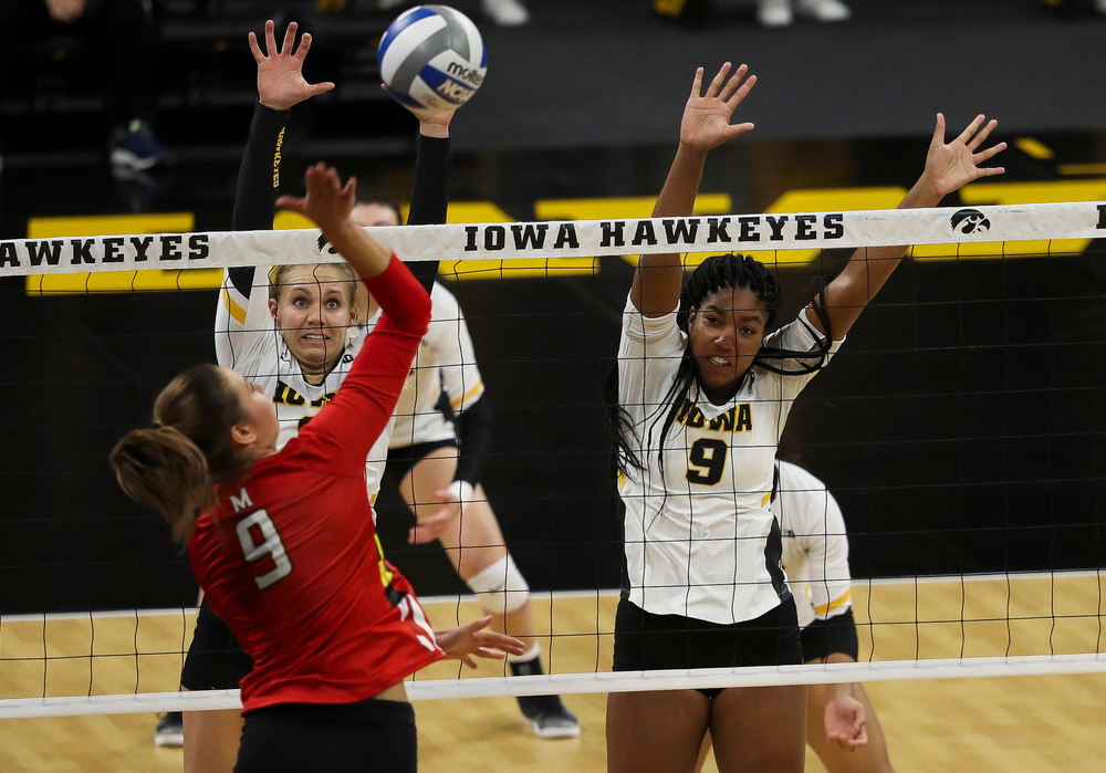 Iowa Hawkeyes right side hitter Reghan Coyle (8) and Iowa Hawkeyes middle blocker Amiya Jones (9) go up for a block during a match against Maryland at Carver-Hawkeye Arena on November 23, 2018. (Tork Mason/hawkeyesports.com)