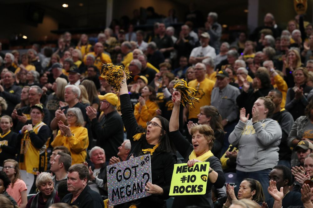 Eva Gustafson and the rest of the fans cheer for the Iowa Hawkeyes against the Indiana Hoosiers in the quarterfinals of the Big Ten Tournament Friday, March 8, 2019 at Bankers Life Fieldhouse in Indianapolis, Ind. (Brian Ray/hawkeyesports.com)