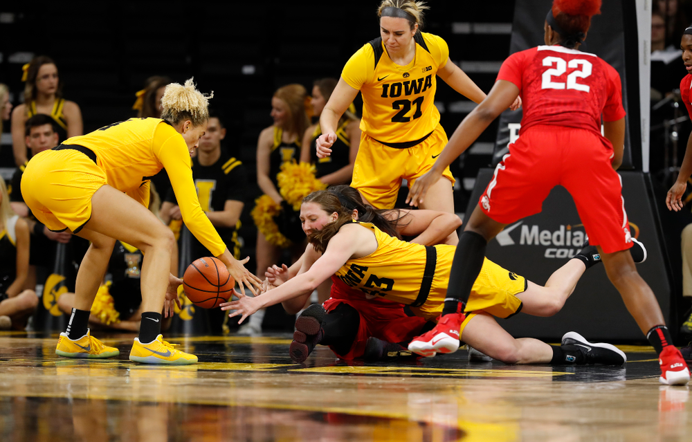 Iowa Hawkeyes forward Amanda Ollinger (43) and forward Chase Coley (4)