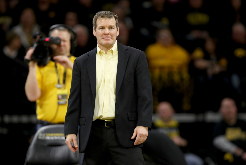 Head Coach Tom Brands works the edge of the mat as Iowa's Michael Kemerer wrestles Ohio State's Kaleb Romero at 174 pounds Friday, January 24, 2020 at Carver-Hawkeye Arena. Kemerer won the match 7-1. (Brian Ray/hawkeyesports.com)