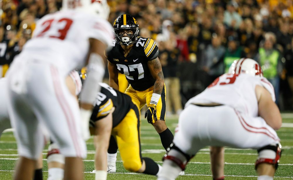Iowa Hawkeyes defensive back Amani Hooker (27) eyes the quarterback during a game against Wisconsin at Kinnick Stadium on September 22, 2018. (Tork Mason/hawkeyesports.com)