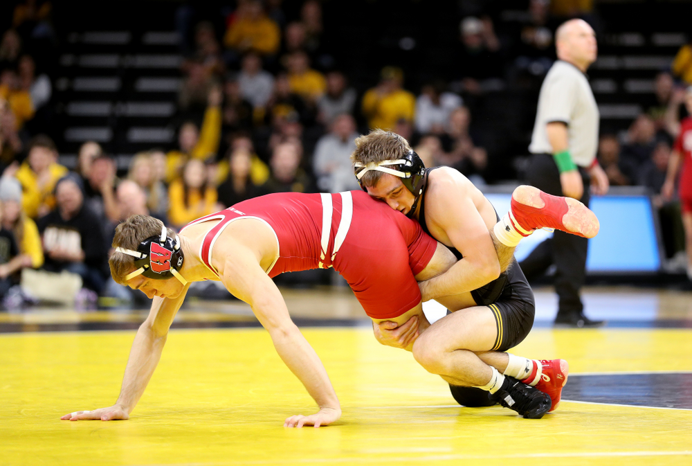 IowaÕs Spencer Lee wrestles WisconsinÕs  Michael Cullen at 125 pounds Sunday, December 1, 2019 at Carver-Hawkeye Arena. Lee won the match with a 16-0 technical fall. (Brian Ray/hawkeyesports.com)