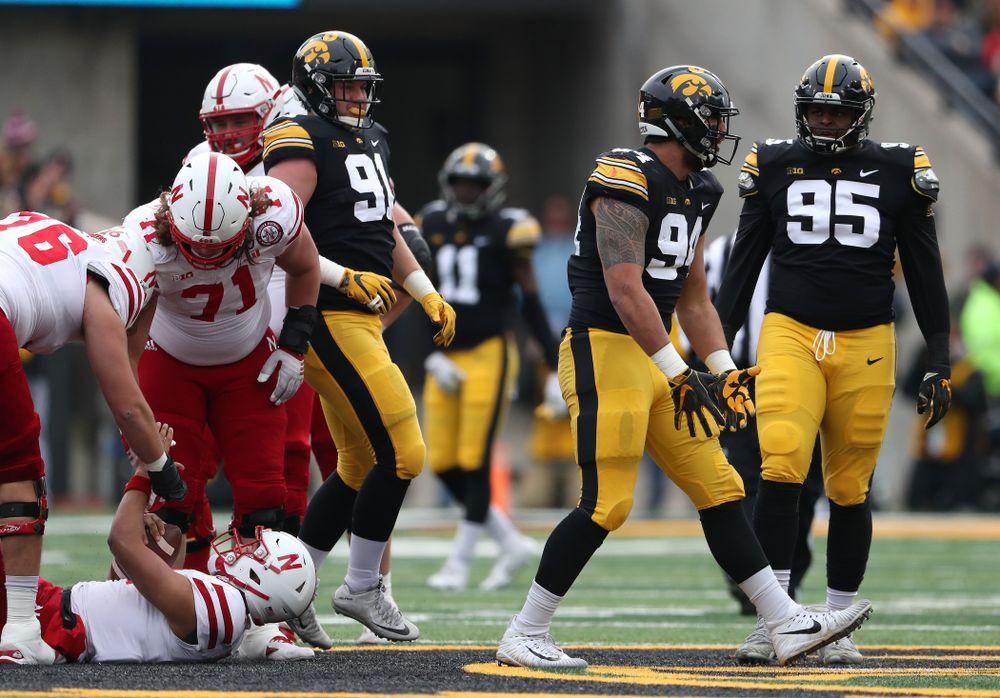 Iowa Hawkeyes defensive end A.J. Epenesa (94) sacks Nebraska Cornhuskers quarterback Adrian Martinez (2)   Friday, November 23, 2018 at Kinnick Stadium. (Brian Ray/hawkeyesports.com)