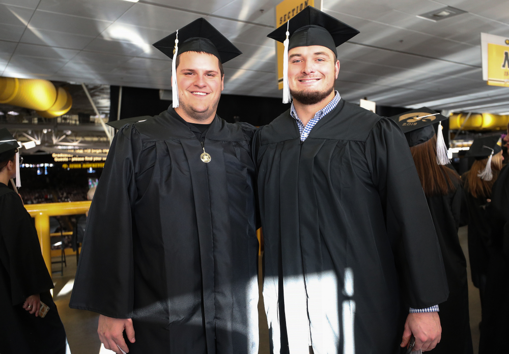 Iowa Football's Keegan Render and Ross Reynolds during the Fall Commencement Ceremony  Saturday, December 15, 2018 at Carver-Hawkeye Arena. (Brian Ray/hawkeyesports.com)
