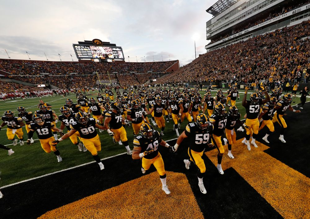 The Iowa Hawkeyes run to get the Cy-Hawk trophy following their game against the Iowa State Cyclones Saturday, September 8, 2018 at Kinnick Stadium. (Brian Ray/hawkeyesports.com)